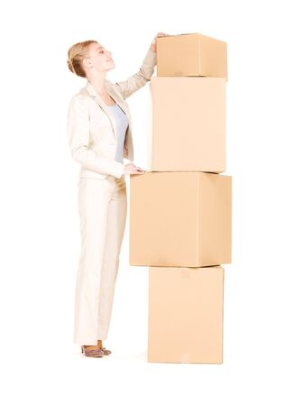 picture of businesswoman with boxes over white Stock Photo - 6398368