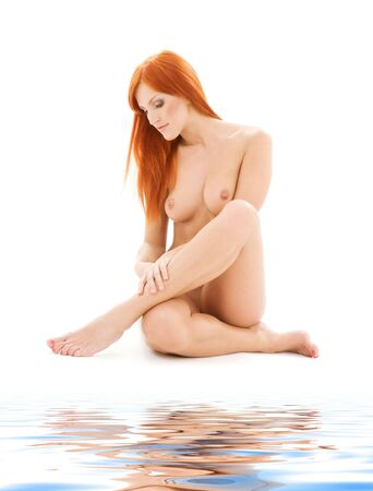 bright picture of healthy naked redhead over white Stock Photo - 6408469