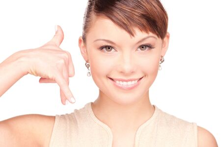 picture of lovely woman making a call me gesture Stock Photo - 6408517