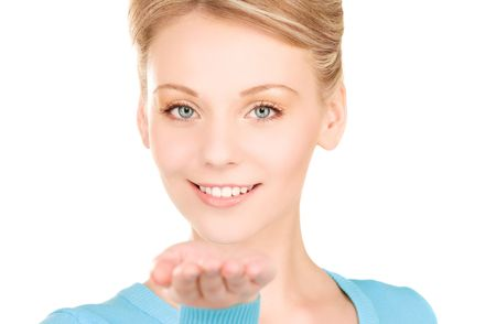 beautiful woman showing something on the palm of her hand Stock Photo - 6408496