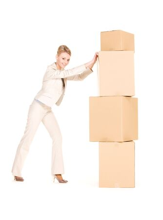 packaging move: picture of businesswoman with boxes over white Stock Photo