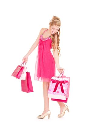 happy woman with shopping bags over white Stock Photo - 6432070