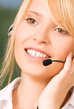 bright picture of friendly female helpline operator Stock Photo - 6454296