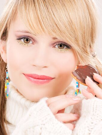 picture of happy teenage girl with cookie Stock Photo - 6469384