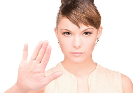 bright picture of young woman making stop gesture Stock Photo - 6510002