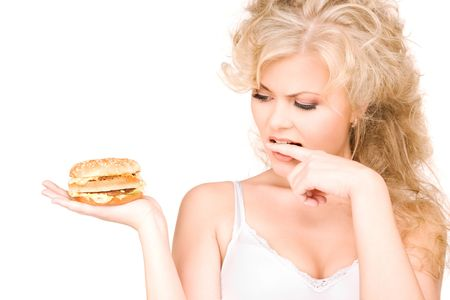 nice food: young beautiful woman with burger over white Фото со стока
