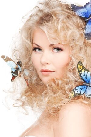 blonde curly hair: picture of lovely woman with butterflies in hair Stock Photo