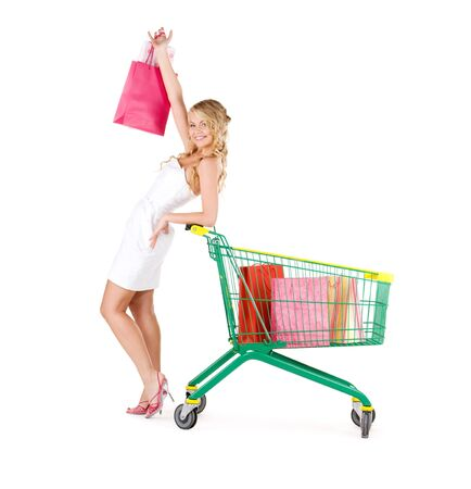 happy woman with shopping bags and cart over white Stock Photo - 6509983
