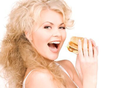young beautiful woman with burger over white photo