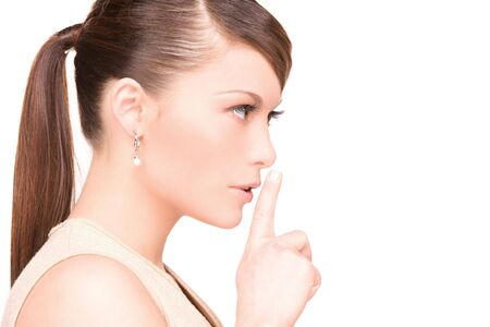 bright picture of young woman with finger on lips Stock Photo - 6525704