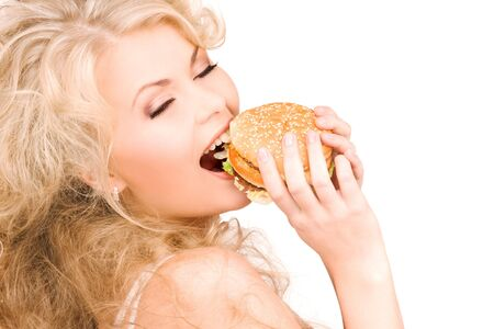 young beautiful woman with burger over white Stock Photo - 6548202