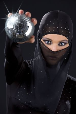 party dancer in ninja dress with disco ball photo
