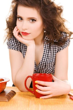 picture of young attractive woman in the kitchen photo