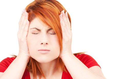 picture of unhappy redhead woman with hands on ears Stock Photo - 6548189
