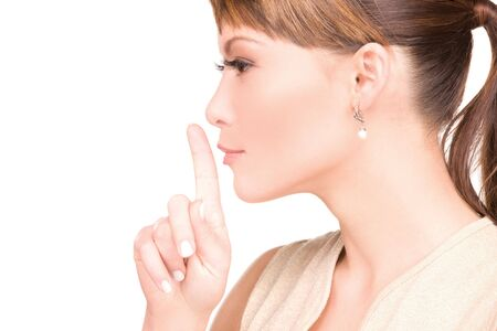 bright picture of young woman with finger on lips Stock Photo - 6571215