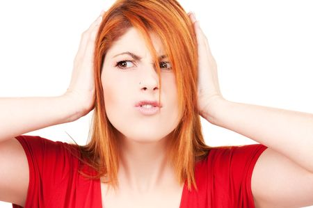 picture of unhappy redhead woman with hands on ears Stock Photo - 6571229
