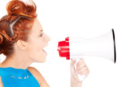 picture of redhead woman with megaphone over white Stock Photo - 6571239