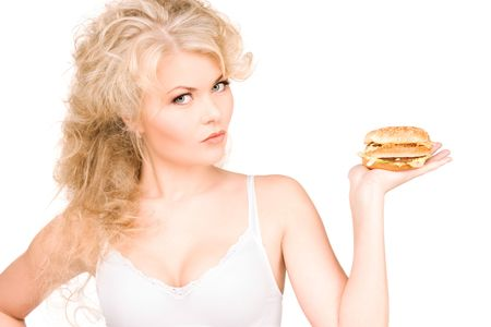 young beautiful woman with burger over white Stock Photo - 6609875