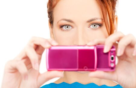 picture of redhead woman using phone camera photo
