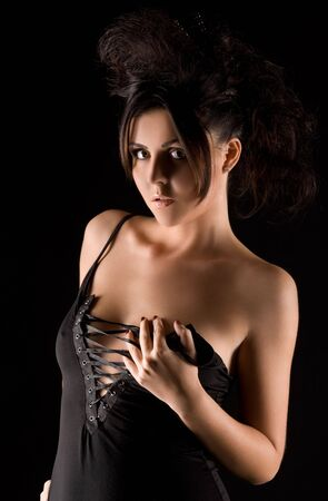 dark picture of sexy woman in black dress Stock Photo - 6609861