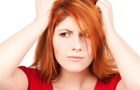 picture of unhappy redhead woman over white photo