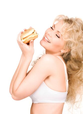 young beautiful woman with burger over white Stock Photo - 6609839
