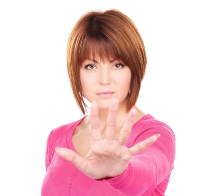 belay: bright picture of businesswoman making stop gesture
