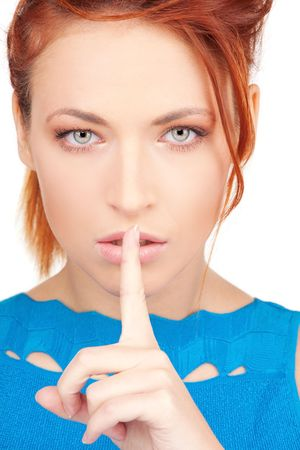 bright picture of young woman with finger on lips Stock Photo - 6609949