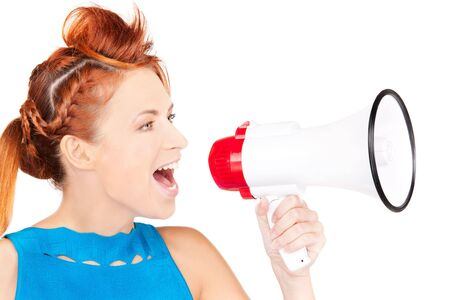 picture of redhead woman with megaphone over white Stock Photo - 6609900