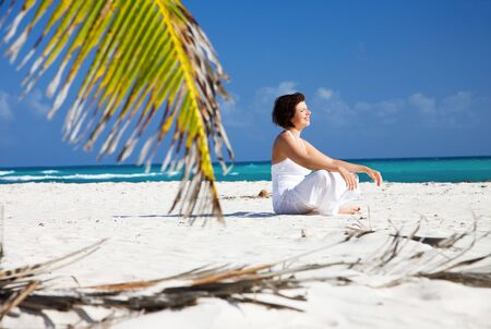 picture of happy woman on the beach photo