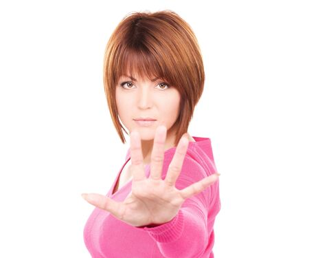 bright picture of businesswoman making stop gesture Stock Photo - 6663805