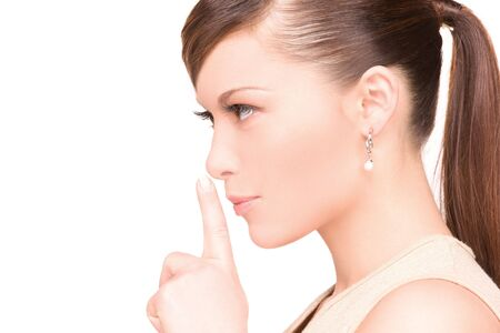 bright picture of young woman with finger on lips Stock Photo - 6663757