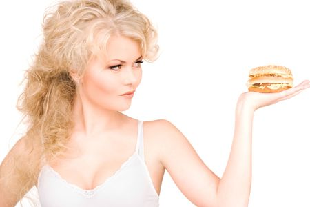 young beautiful woman with burger over white Stock Photo - 6663799