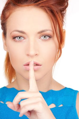 bright picture of young woman with finger on lips Stock Photo - 6663801