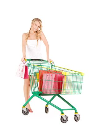 happy woman with shopping cart over white Stock Photo - 6663762