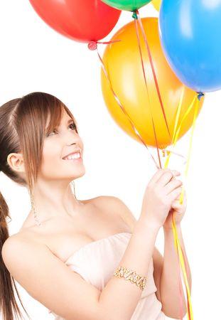 chicas guapas: feliz adolescente con globos sobre blanco Foto de archivo