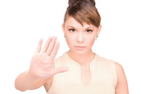 bright picture of young woman making stop gesture Stock Photo - 6663741