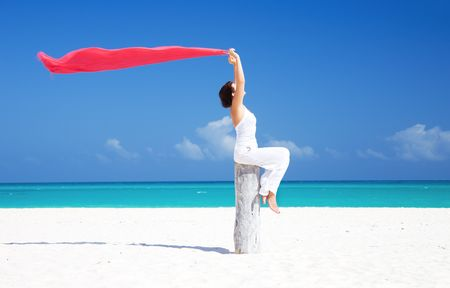 happy woman with red sarong on the beach photo