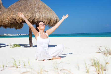 meditation of happy woman in lotus pose on the beach Stock Photo - 6681703