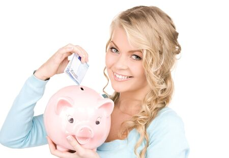picture of lovely woman with piggy bank and money photo