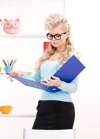 bright picture of young businesswoman in office photo
