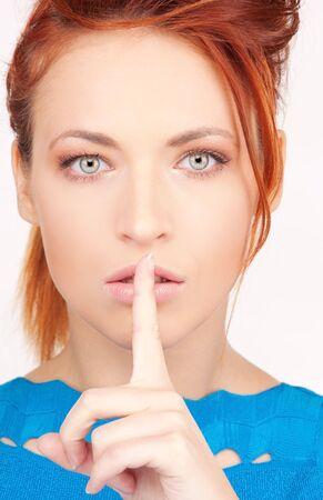 bright picture of young woman with finger on lips Stock Photo - 6681728