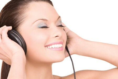 picture of happy woman in headphones over white Stock Photo - 6710177