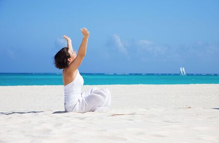 meditation of happy woman in lotus pose on the beach Stock Photo - 6710171