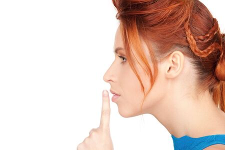 bright picture of young woman with finger on lips Stock Photo - 6710336