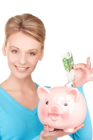 picture of lovely woman with piggy bank and money Stock Photo - 6710279