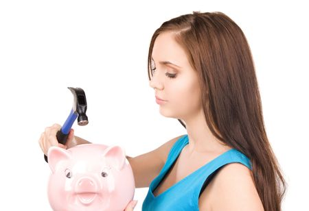 lovely teenage girl with piggy bank and hammer Stock Photo - 6710303