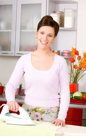picture of ironing woman in the kitchen Stock Photo - 6761433