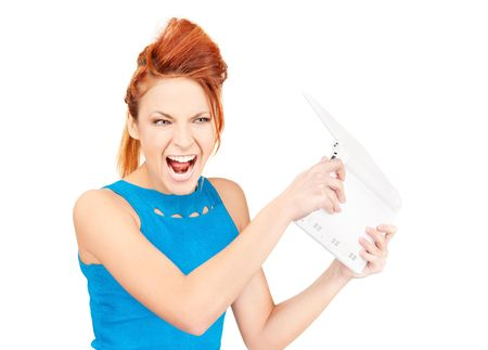 picture of angry woman with laptop computer Stock Photo - 6760576
