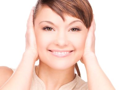 hands over ears: picture of smiling woman with hands over ears